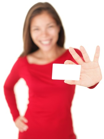 1 person: Business card woman holding a blank gift card isolated on white background. Out of focus person showing or giving an empty sign.
