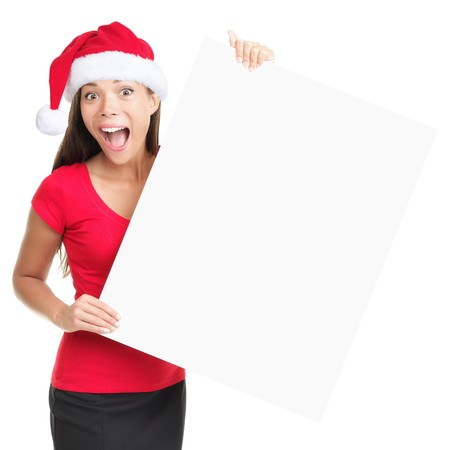 Billboard woman in santa hat surprised for Christmas. Surprised asian beautiful happy model showing blank sign isolated on white background. photo