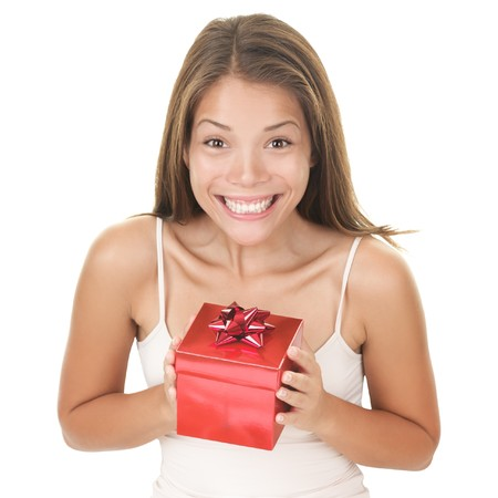 Happy woman with christmas gift surprise. Beautiful asian woman holding red gift box for valentines day or birthday. photo