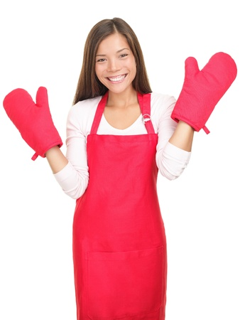 woman baking: Young woman with cooking mittens isolated on white background. Asian  Caucasian woman happy.