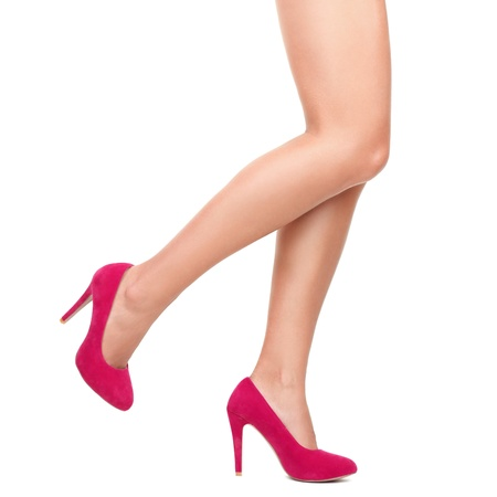 Sexy legs in pink high heels isolated on white background. photo