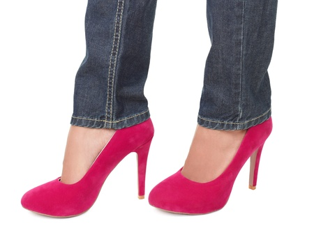 pink high heels and jeans isolated on white background. photo