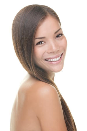 head and shoulder: Natural beauty woman smiling. Beauty portrait of brunette with perfect natural fresh look and skin. Isolated on white background. Mixed Caucasian  Asian female model.