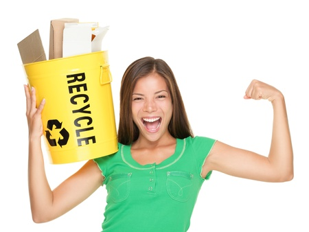 recycle symbol: Recycle woman holding recycling bin with paper showing muscles. Funny recycle concept isolated on white background. Asian  Caucasian female model. Stock Photo