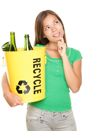 glass containers: Recycle woman thinking looking up at copy space. Beautiful young woman holding recycling basket isolated on white background.