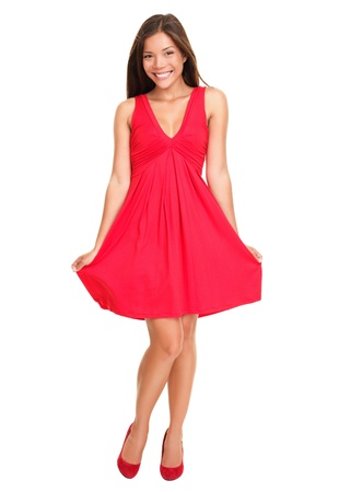 Gorgeous woman. Portrait of beautiful smiling young woman standing in cute red dress isolated on white background in full length. Sexy mixed race Chinese Asian  Caucasian female model. photo