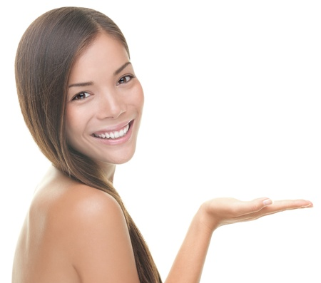 beauty: Beauty portrait of beautiful woman showing beauty product  empty copy space on open hand palm. Mixed race Asian  Caucasian female model isolated on white background.