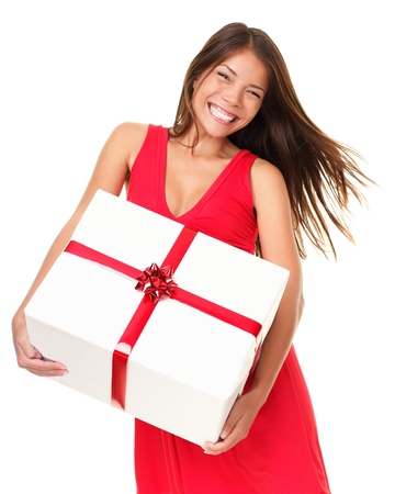 Asian woman holding big gift happy and excited. Isolated on white background.