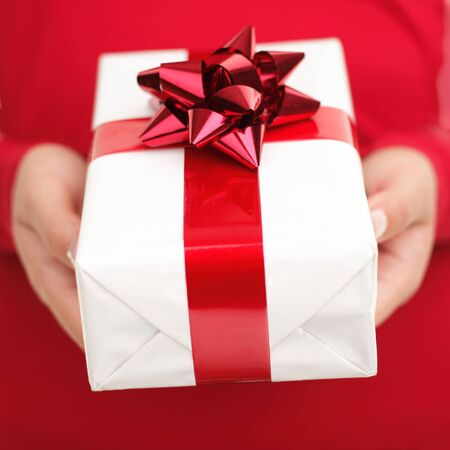 Present  gift.  Close up of woman holding valentines day gift. Red and white colors. photo
