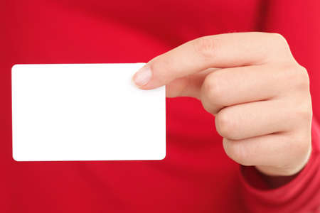hand business card: Person showing business card. Closeup of woman holding blank empty business card.