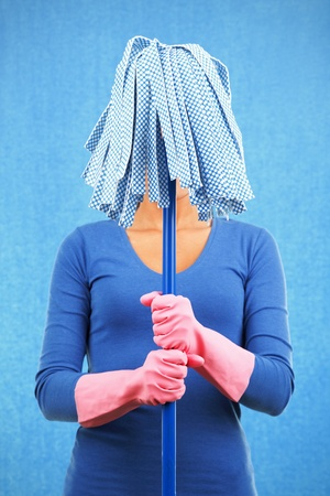 domestic chore: Cleaning funny woman holding mop ready for spring. Stock Photo