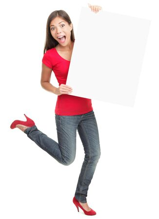 a placard: Excited young woman holding empty white board isolated on white background. Stock Photo