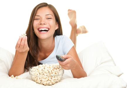 Woman watching funny movie laughing. Isolated on white background.