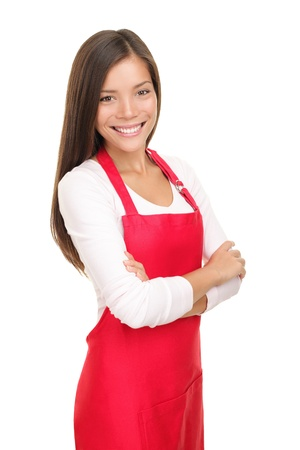 Beautiful young sales clerk or small shop owner isolated on white background. Smiling young woman. photo