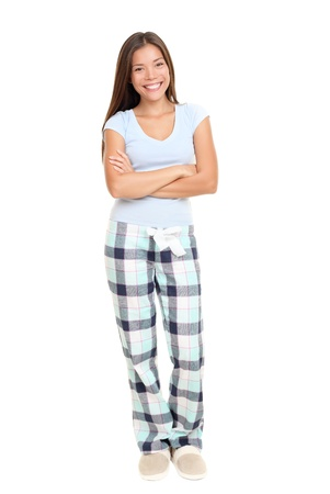 lady        slipper: Woman standing in pajamas smiling isolated on white background in full length.