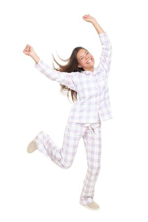 bedroom: Pajamas woman dancing cheerful. Isolated on white background in full body.  Stock Photo