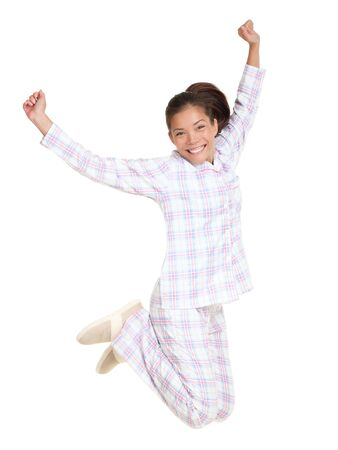 Jumping pajamas woman morning fresh and cheerful.  photo