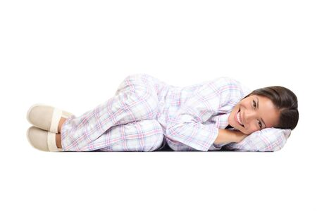 positions: Woman lying down cute in pajamas and slippers. Isolated on white background.