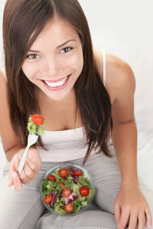 Salad woman eating healthy bowl of salad. photo