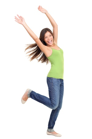 woman dancing: Success woman dancing and celebrating standing in full length isolated on white background. Natural beauty having fun. Mixed-race Asian Chinese  white Caucasian female model.