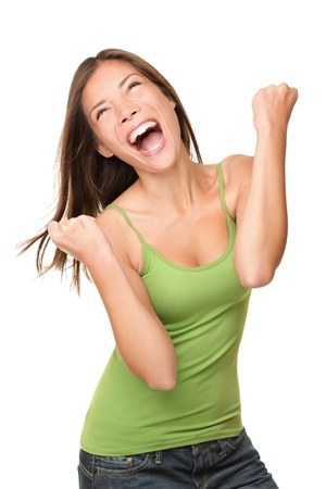 Winning success woman happy ecstatic celebrating being a winner. Dynamic energetic image of multiracial Caucasian Asian female model isolated on white background waist up. photo