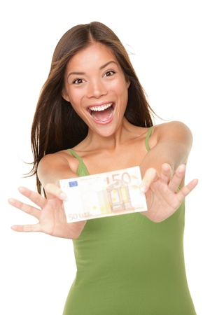 Euro money woman showing 50 euro bill happy and excited isolated on white background. Pretty casual Asian woman winner.