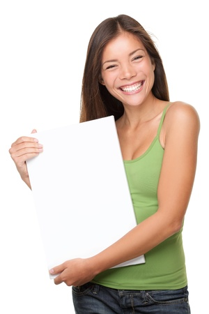 blank poster: Woman showing sign. Cute causual young beautiful woman showing blank white sign isolated on white background waist up. Pretty, lovely and fresh asian caucasian female model.