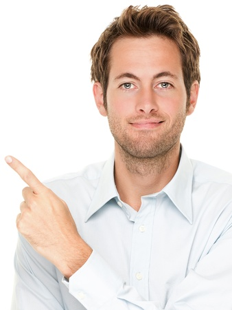 Man pointing showing copy space isolated on white background. Casual handsome Caucasian young businessman.