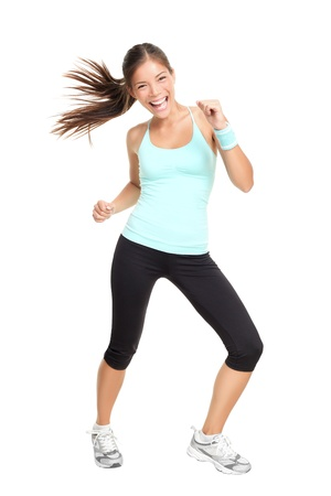 Fitness woman exercising dance aerobics in full length isolated on white background. Mixed race Asian Caucasian female model. photo