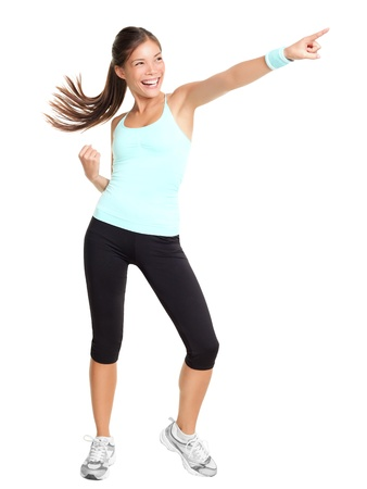 Fitness woman doing aerobic pointing. Sporty energetic beautiful model isolated in full length on white background.