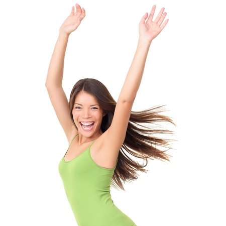 Isolated joyful carefree happy portrait of a young woman isolated on white background waist up. Beautiful Caucasian Asian multiracial female model in green tank top photo