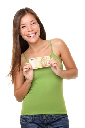 Euro money woman showing 50 euro bill happy and excited isolated on white background. Beautiful casual Asian Caucasian young woman.