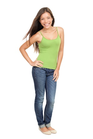 Portrait of woman standing isolated. Beautiful, casual sexy and fresh young mixed race Asian Caucasian female model standing isolated on white background in full body. Banque d'images