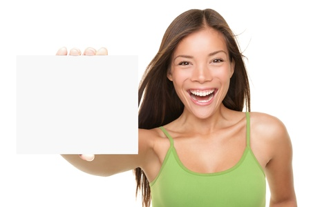 Gift card sign woman. Excited young female showing empty blank paper note card with copy space for text. Very fresh and beautiful multi-ethnic Chinese Asian  white Caucasian female model isolated on white background. Focus on both sign and model. photo