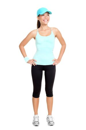 本文全体の中で孤立した白い背景に立っているフィットネス女性。若い新鮮でヘルシーな混合レース アジアコーカサス地方の女性モデル 写真素材