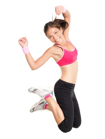Weight loss fitness woman jumping of joy. Young sporty fit mixed race Asian  Caucasian female model isolated on white background in full body