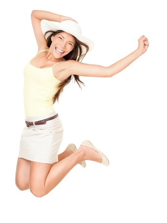 full length woman: Summer woman jumping of joy excited. Beautiful mixed race woman isolated on white background. Asian Chinese and Caucasian ethnicity.