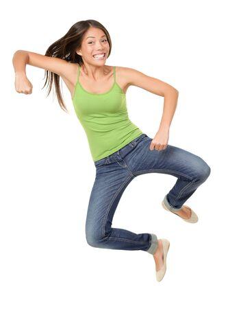 tacones: Saltar a mujer aislada. Divertido saltando de la mujer de Asia cauc�sica casual de raza mixta aislada sobre fondo blanco usando reen sin mangas y pantalones vaqueros