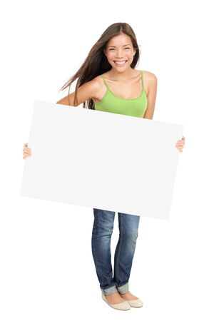 holding a sign: Woman holding billboard sign smiling fresh. Caucasian  Asian woman isolated on white background in full figure.
