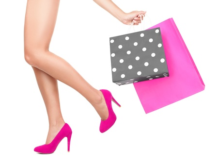 fashion shoes: Shopping bag woman - shopper concept. Closeup of woman legs and shopping bags- Isolated on white background.