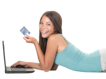 buying: Woman shopping on internet using credit card. Young asian caucasian woman lying down isolated on white background.