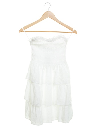 White dress on hanger isolated on white background Stock Photo