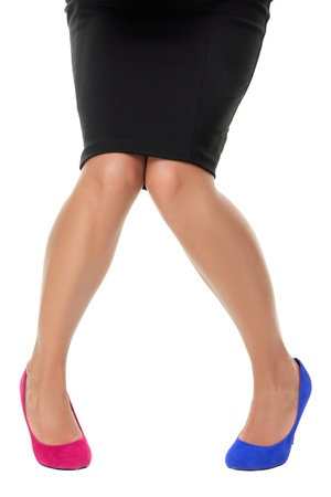 Wrong shoe. Woman wearing the wrong high heel shoes. Closeup isolated on white background