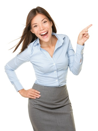 Pointing woman excited, happy and cheerful showing empty copy space with room for product, text etc. mixed race Asian Caucasian woman professional isolated on white background. photo