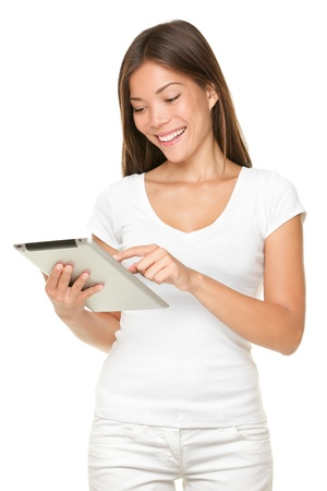Woman holding tablet computer isolated on white background. looking at and touching screen. Casual smiling caucasian asian woman.