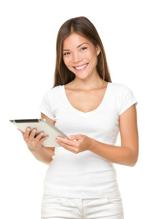 Tablet computer woman smiling isolated on white background standing with touchpad PC.