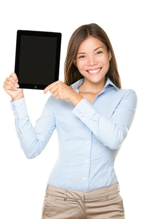 exhibiting: Woman showing tablet computer touch pad screen with copy space. young mixed race Asian Caucasian business woman professional isolated on white background. Stock Photo