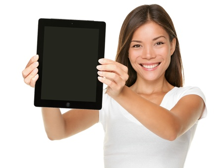 Tablet computer. Woman showing touchpad screen of tablet PC. Touch pad screen and model both in focus. Happy Multiracial Asian Caucasian girl smiling isolated on white background photo