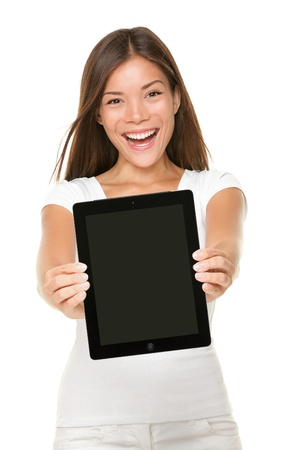 Tablet touch pad computer. Woman showing touchpad screen of tablet PC. Screen and model are both sharp. Cheerful happy mixed-race Caucasian Asian girl smiling excited isolated on white background photo