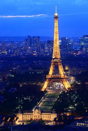 parisian scene: PARIS, FRANCE - JUNE 18: Eiffel Tower Paris, 2011. Night dusk scene showing Eiffel tower light lit up. Editorial